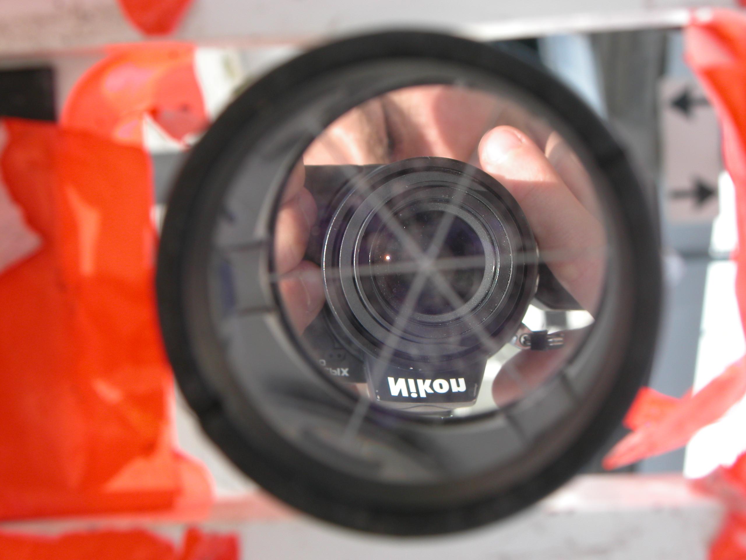 nikon camera in reflection in mirror