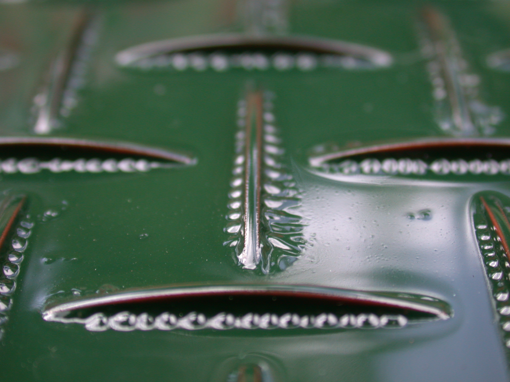 metal hole holes green ribbed royalty-free