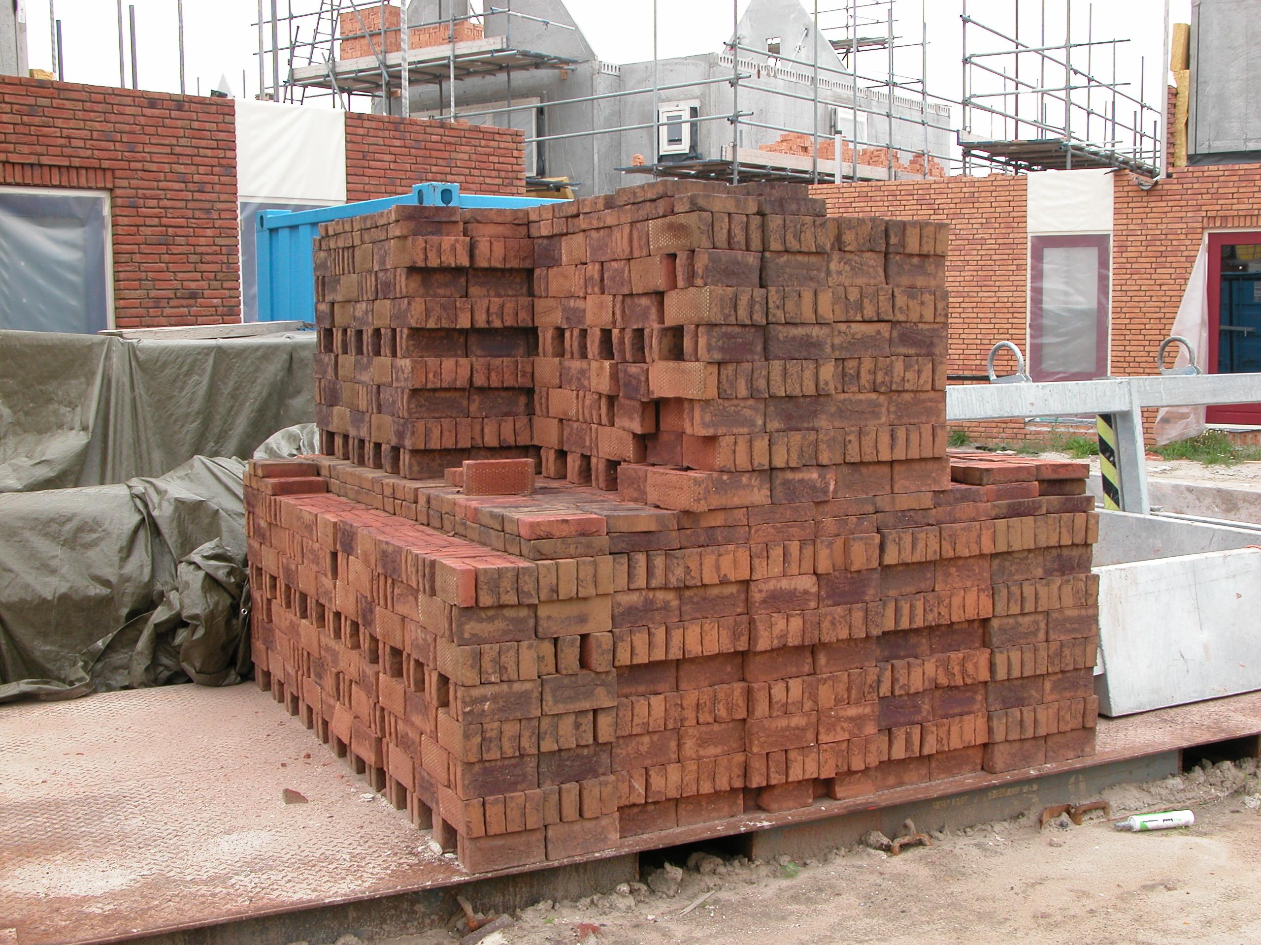 brick bricks construction site constructing pile heap pallet