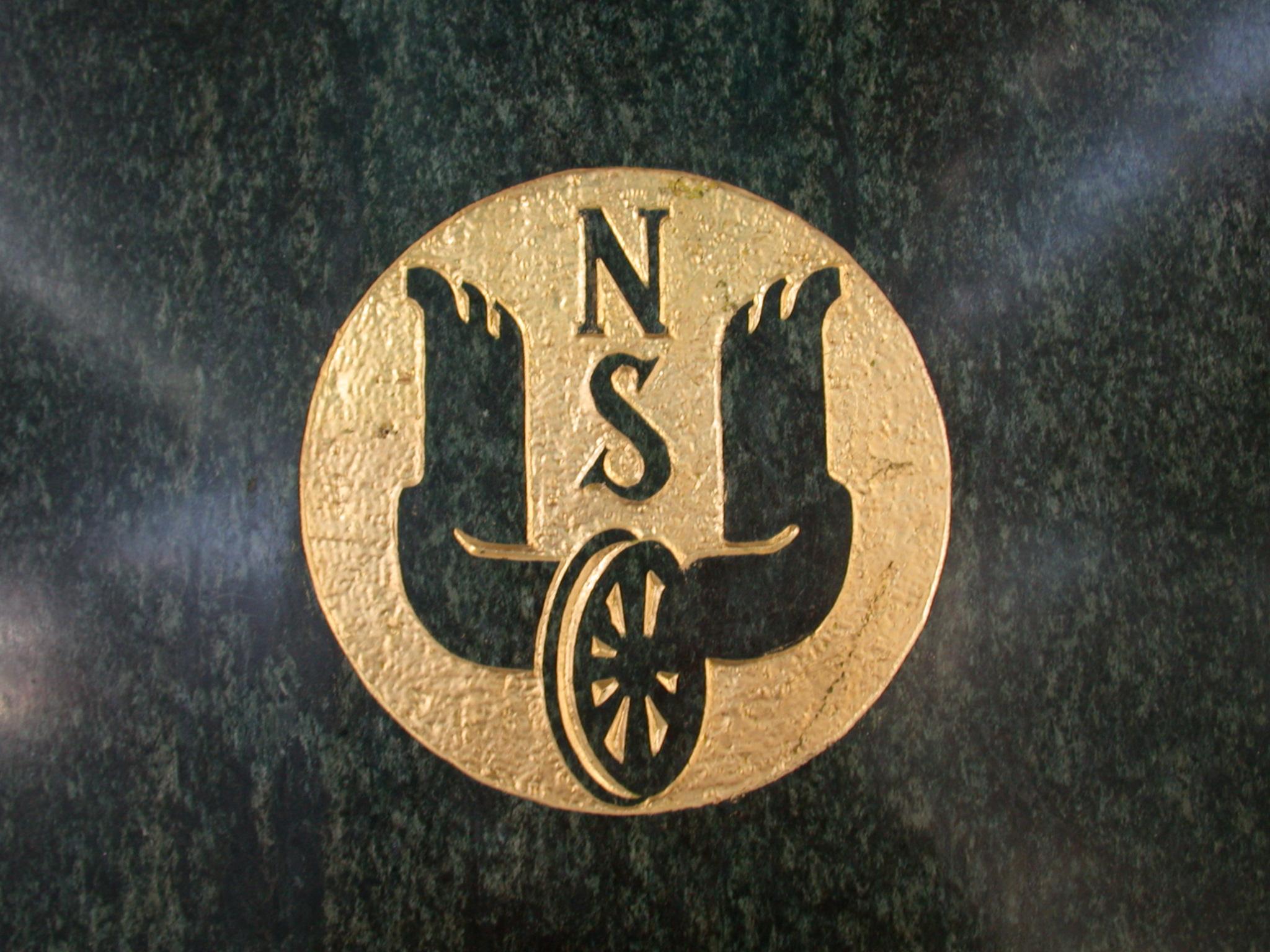 ns logo black gold yellow circle wheel wing wings railways