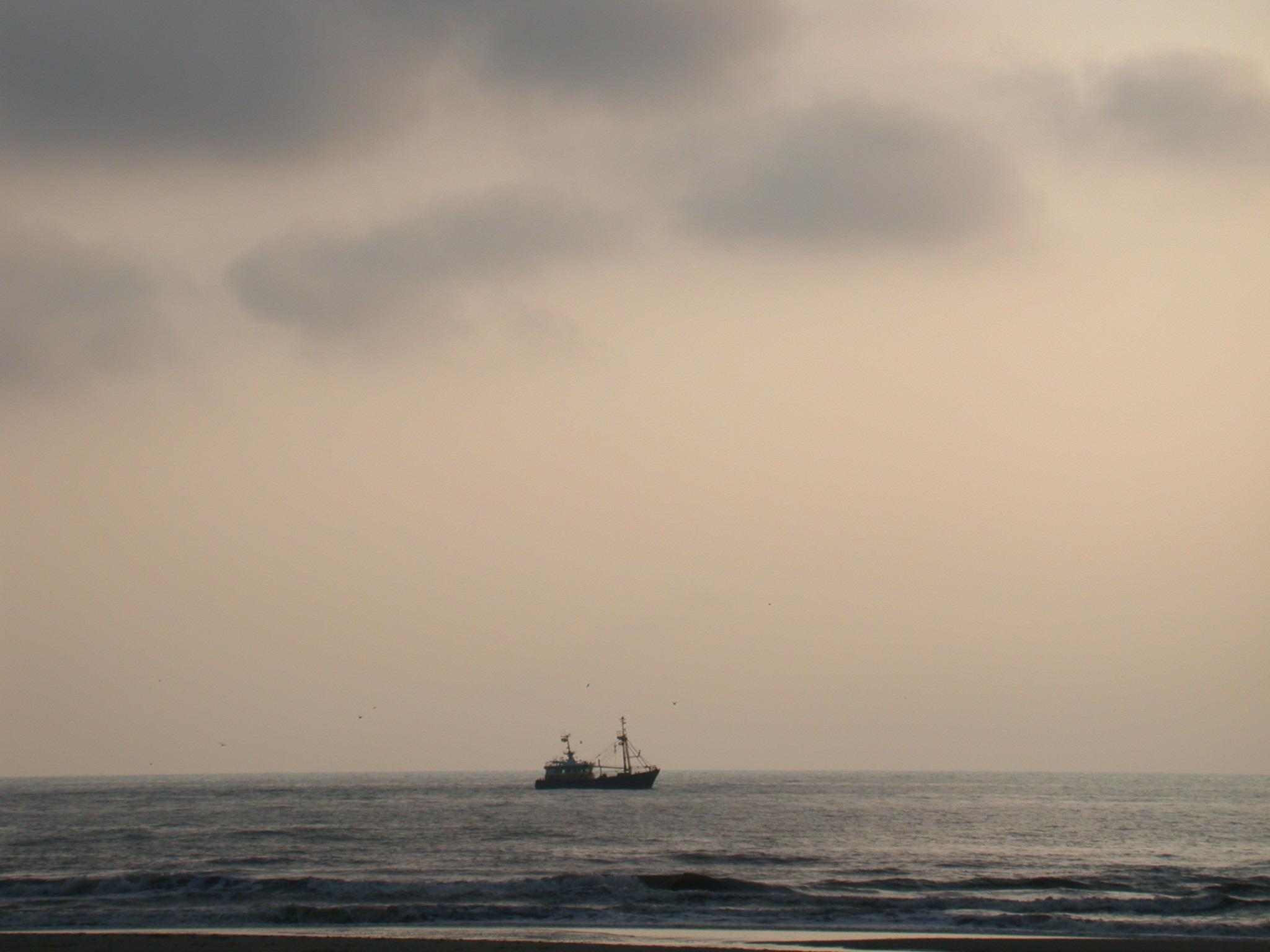 ship at sea ocean fisherman