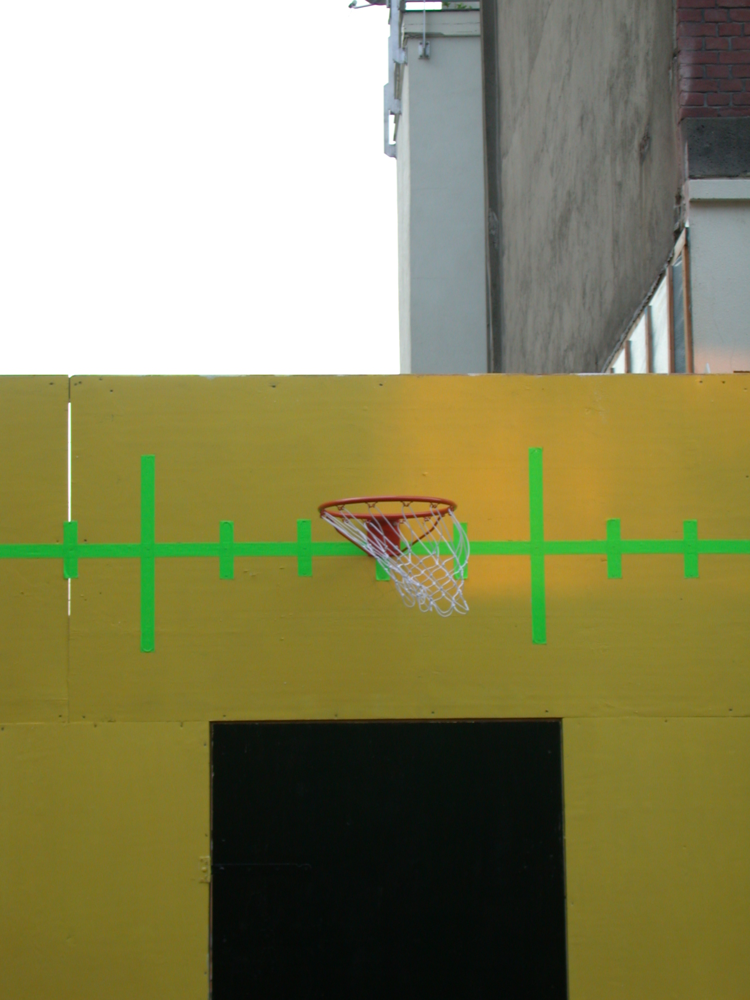 basketball hoop on yellow wall sports