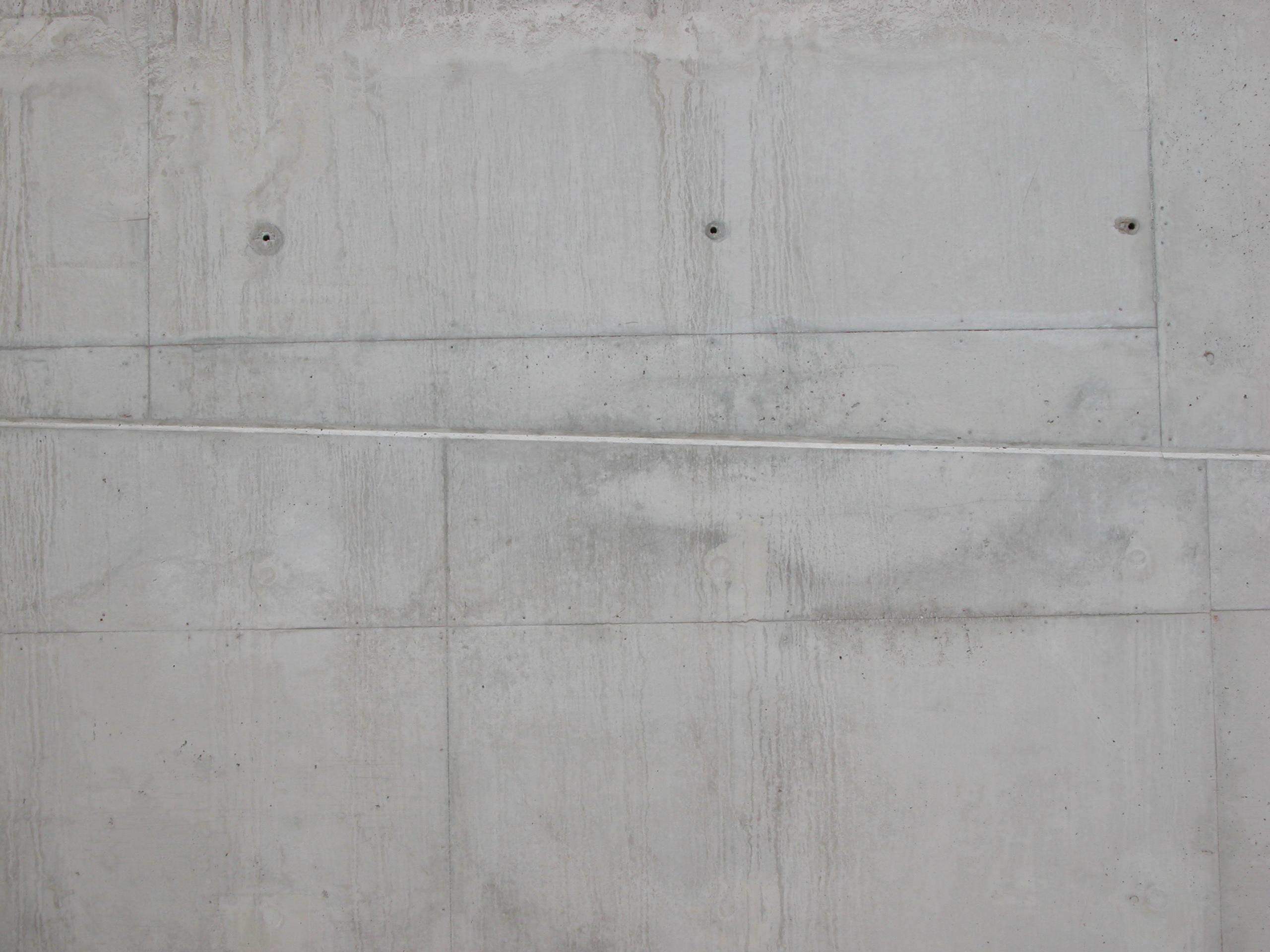 concrete wall holes grey gray