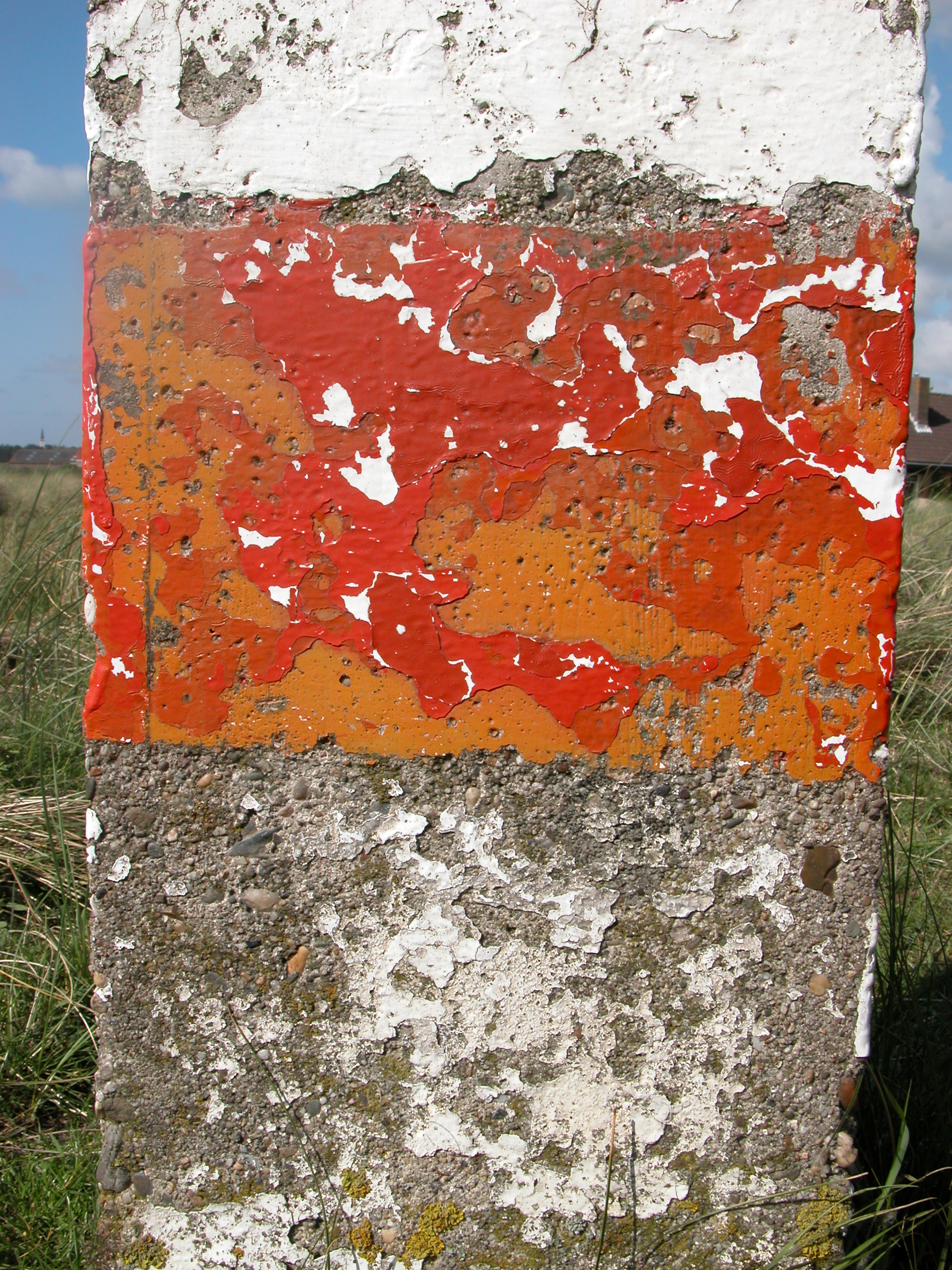 pole stone post chipped paint concrete sign