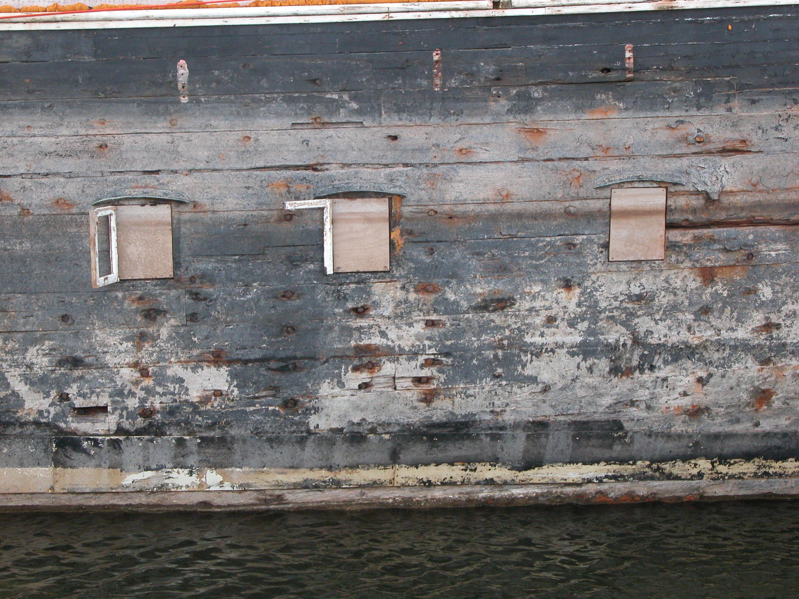 wooden boat side windows boarded up