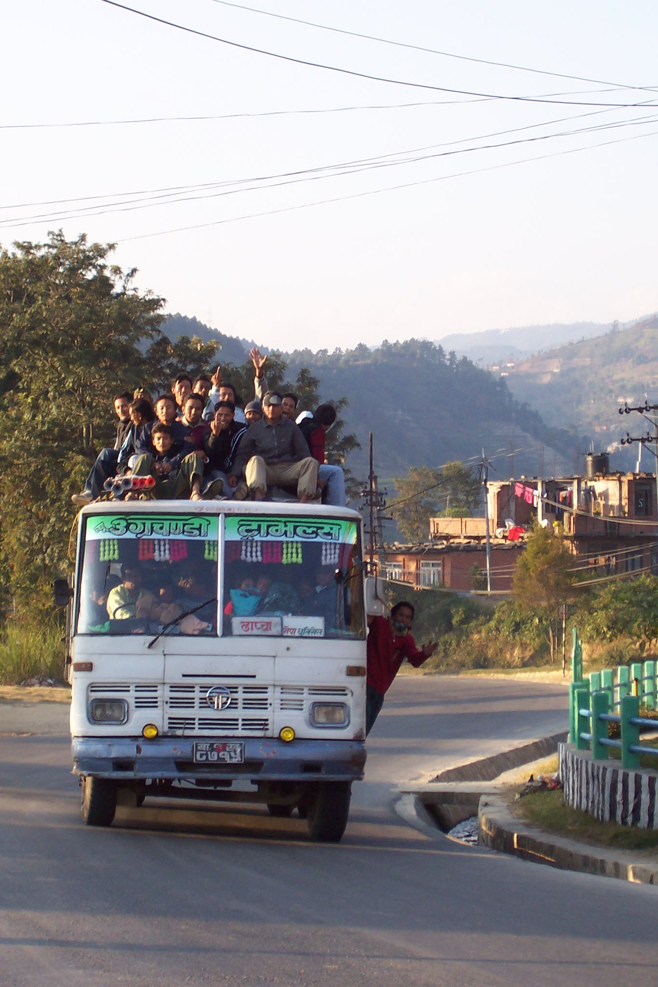 annet bus transport vehicle passengers people sitting on top