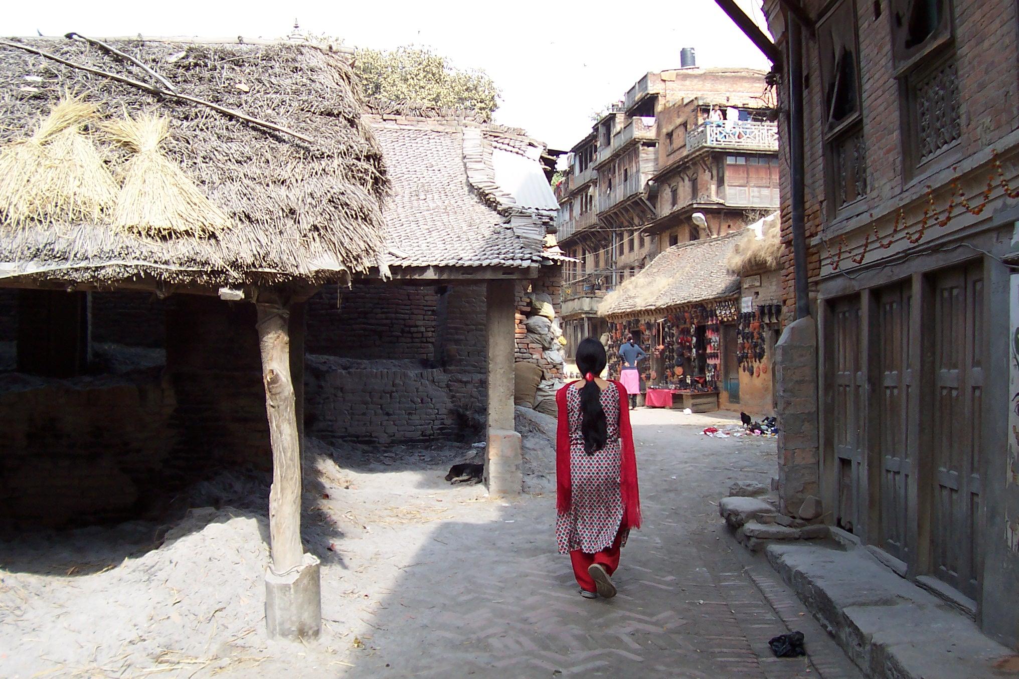 woman walking in street annet asian country shop street sunny