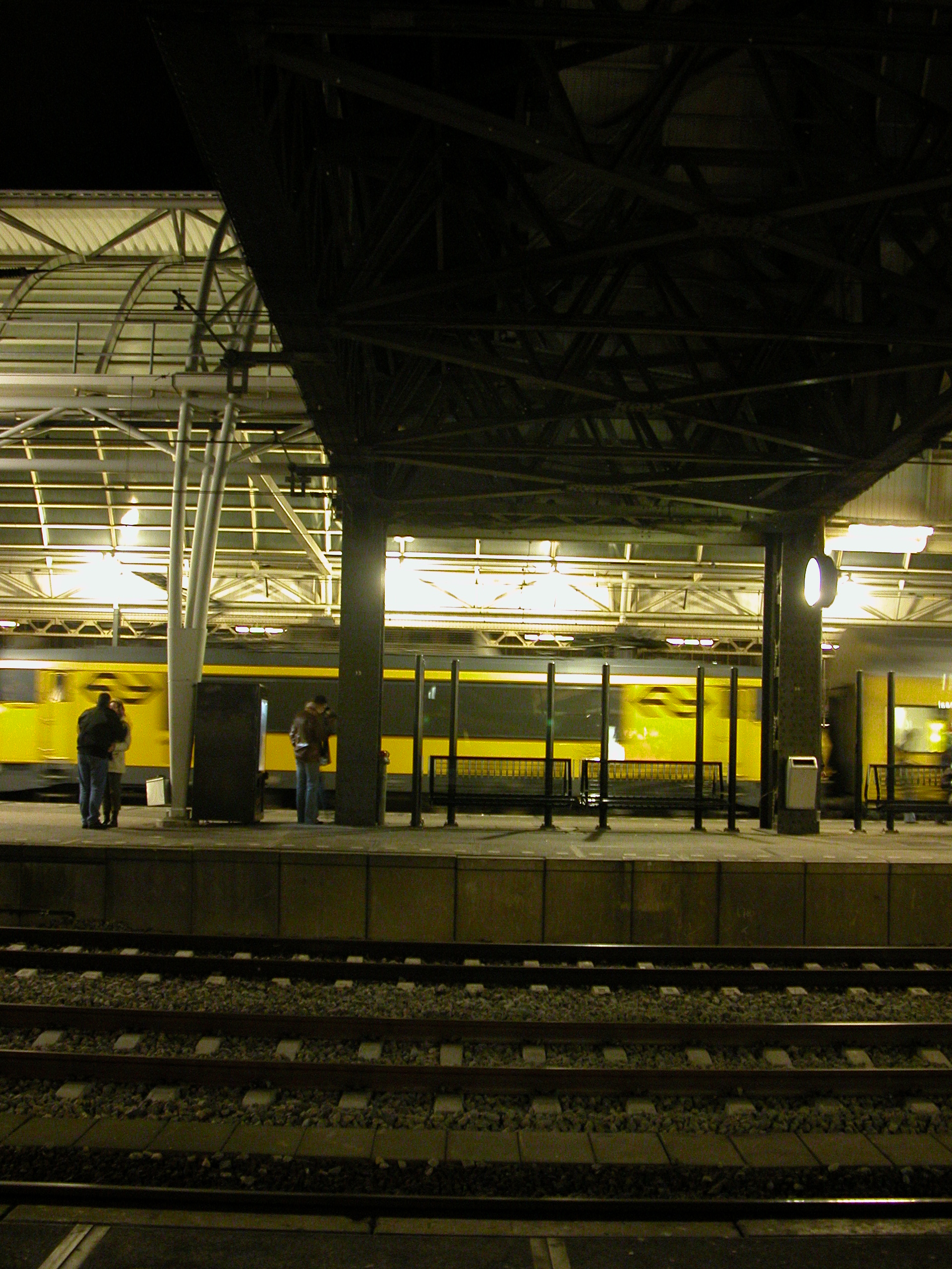 train trains station speeding past rails