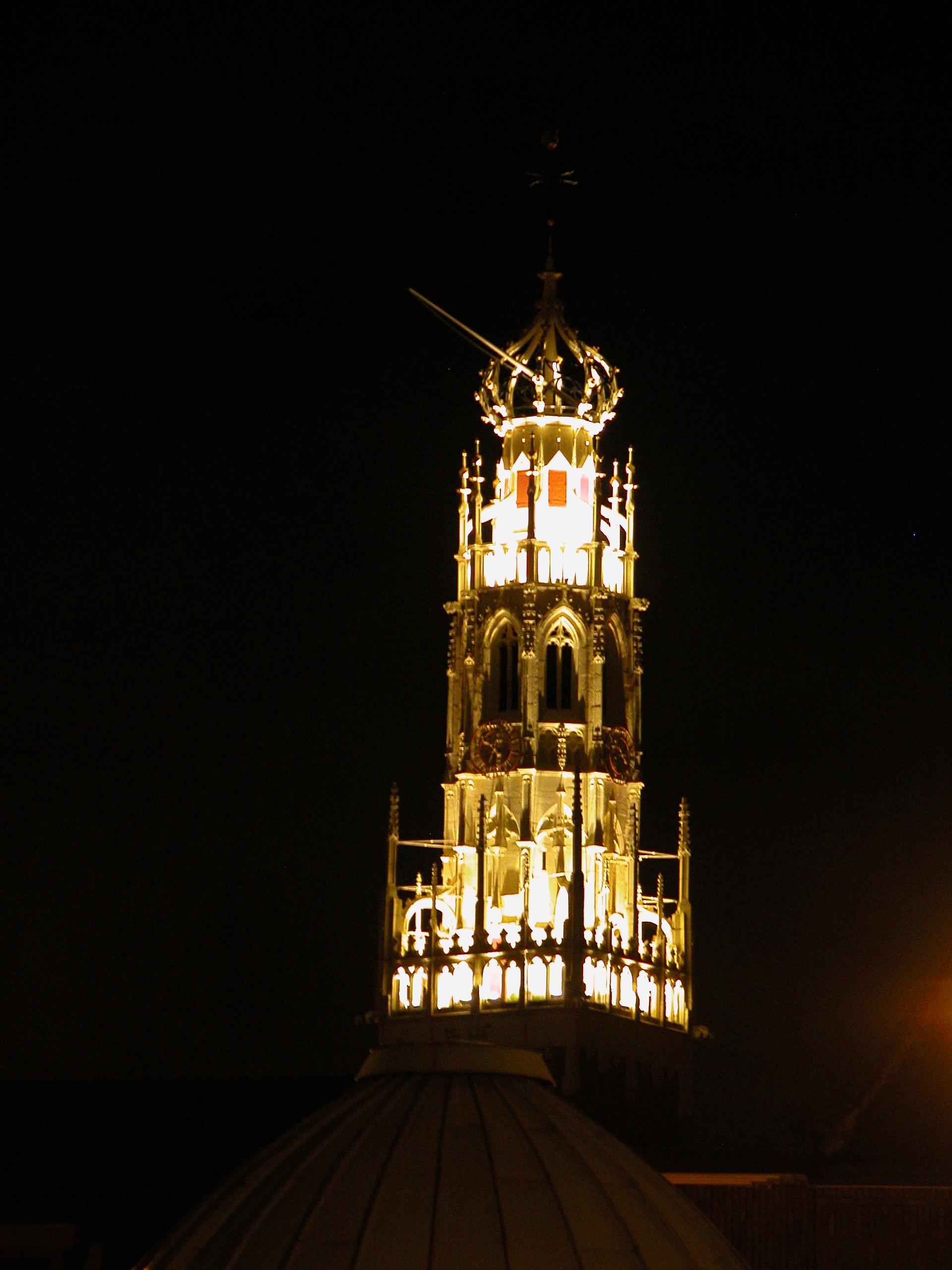 tower spire night lit up light lights