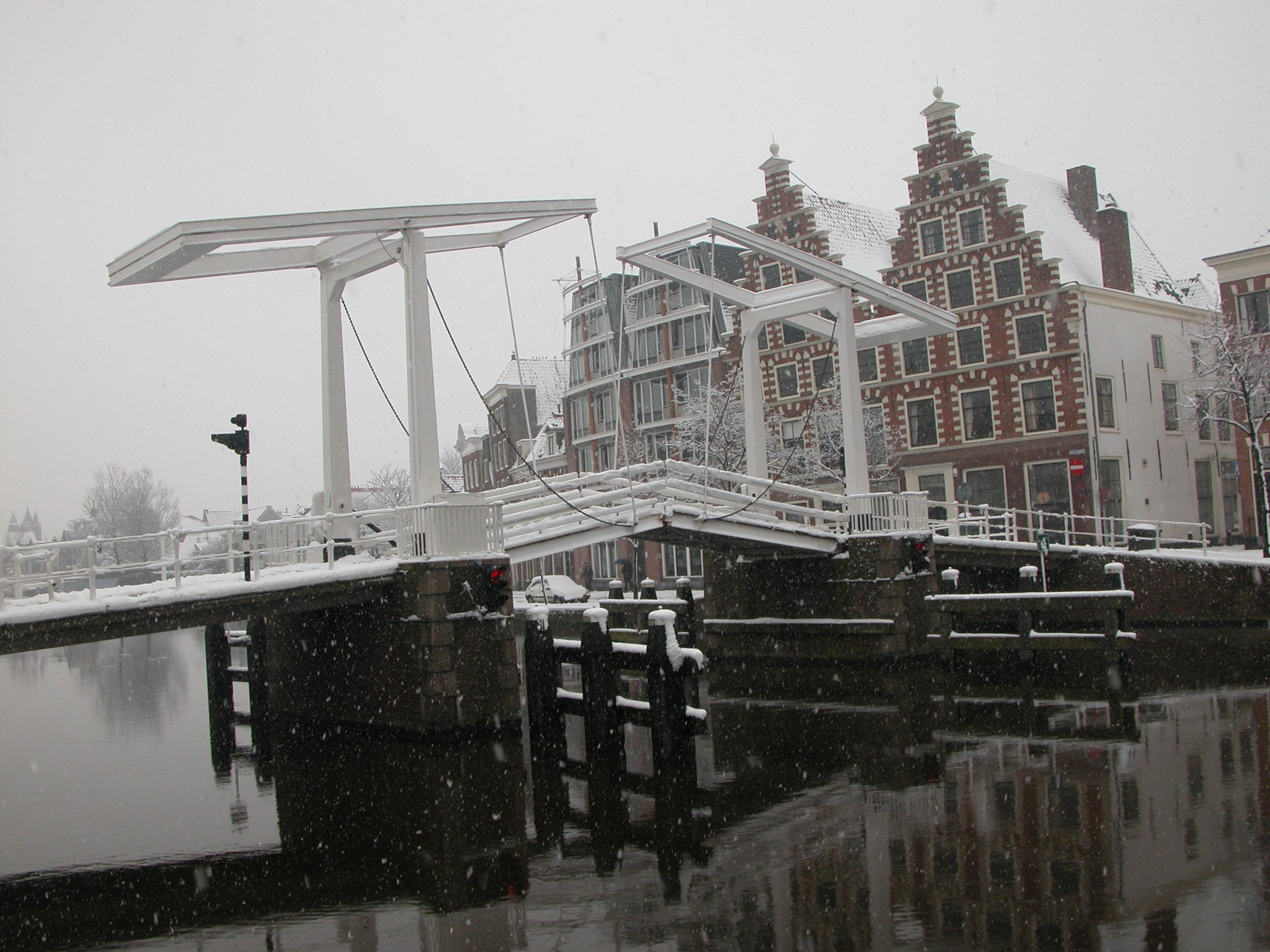 drawbridge bridge snow haarlem city stepped gable dutch house houses architecture exterior royalty free