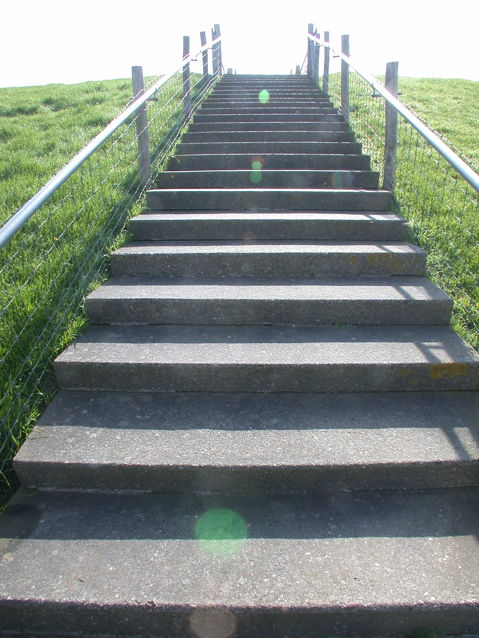 dike stairs steps railing grass