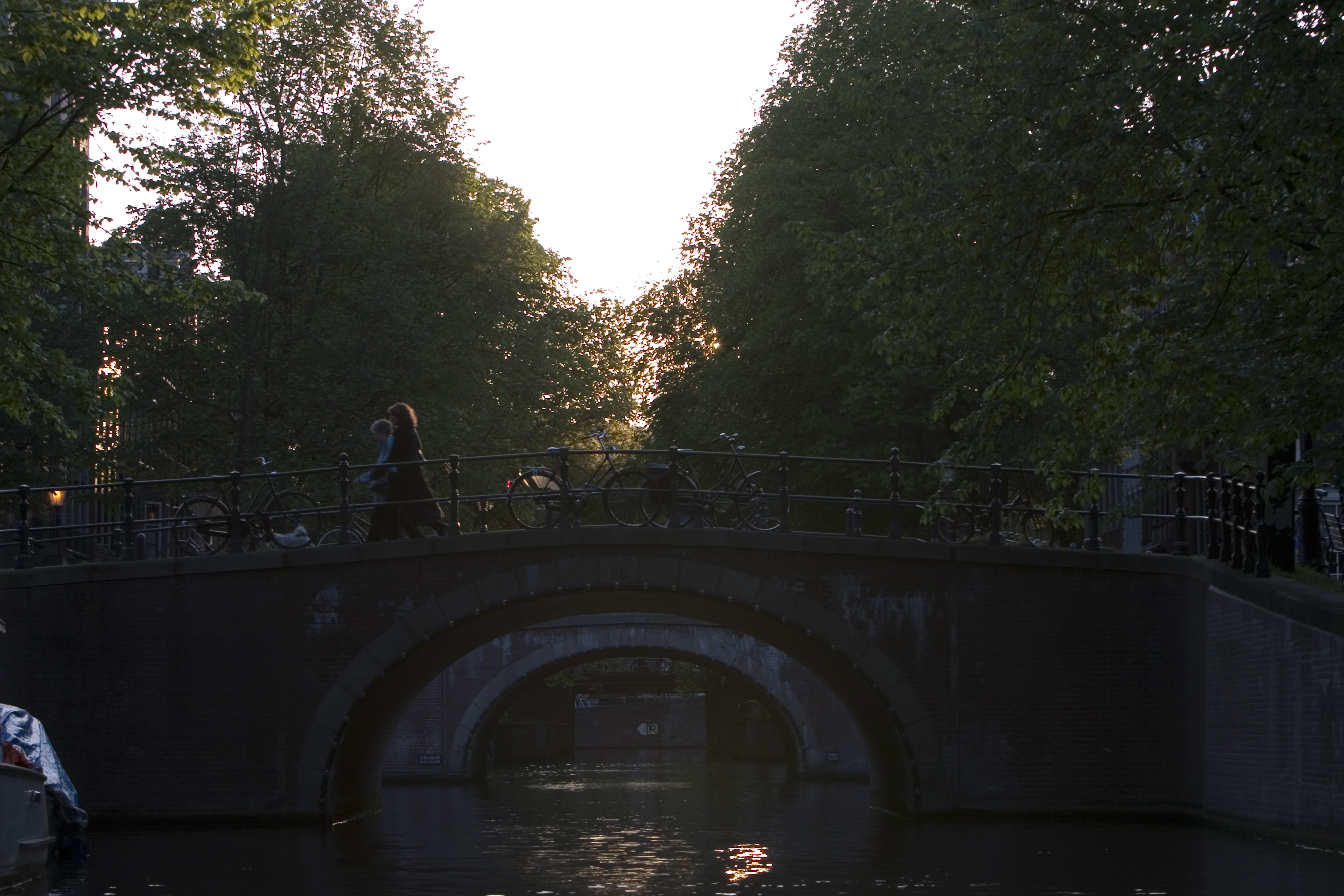 canal bridge city guard rail bike bikes bicycle bicycles city trees architecture exterior