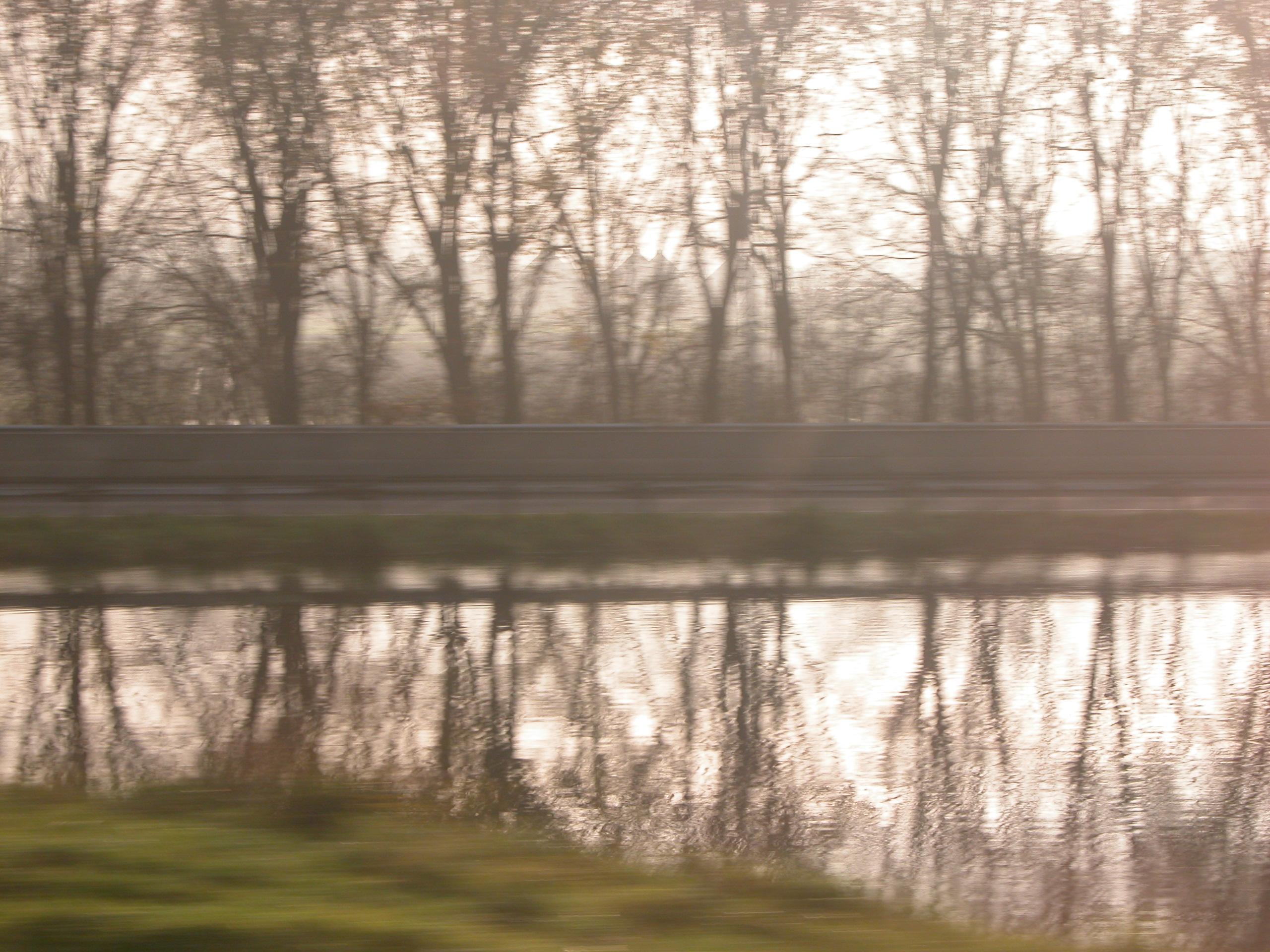 blurs trees water mirroring speed speeding nature landscapes