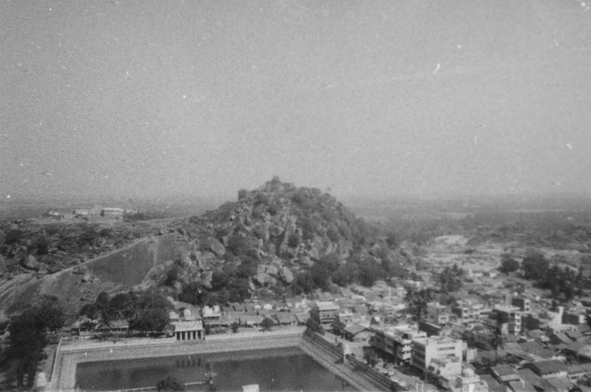 iuliana old picture of an city next to a mountain and a square water pool