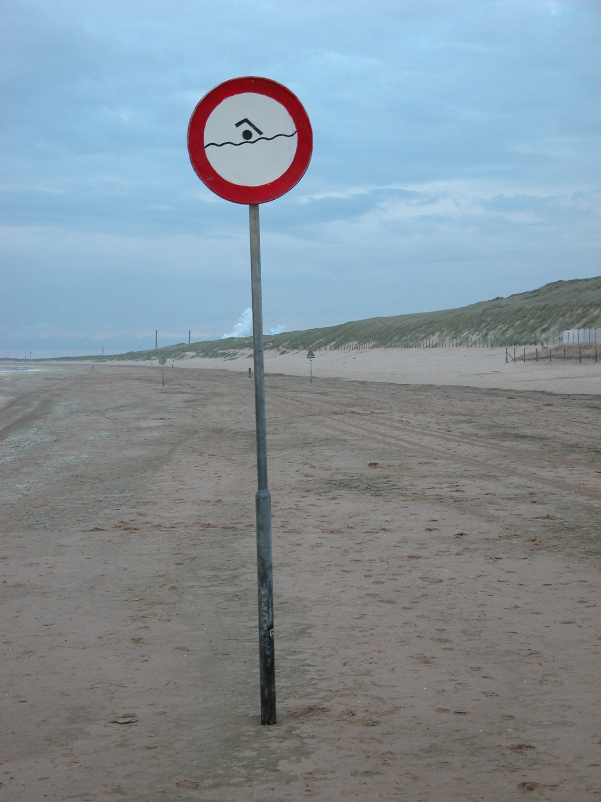 objects signs forbidden to swim swimming beach beachscape circle