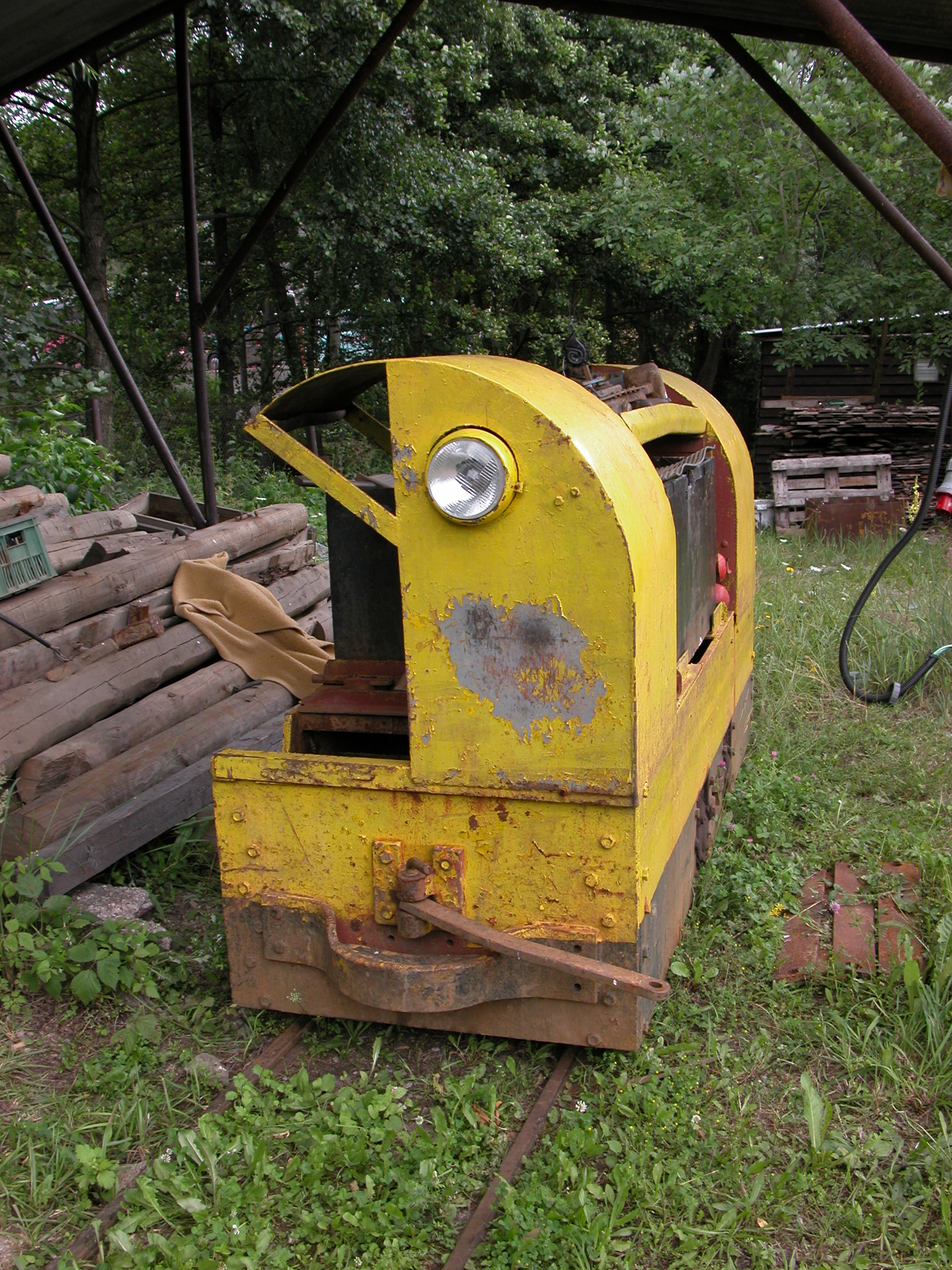 train engine yellow metal rails abandoned rubbish trash