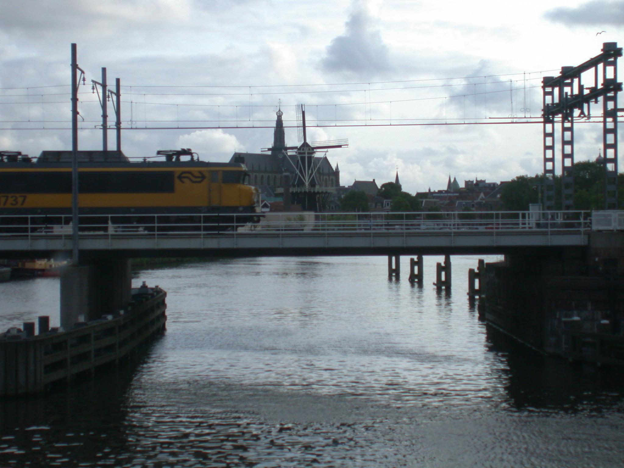train bridge speed wind mill church Netherlands Holland