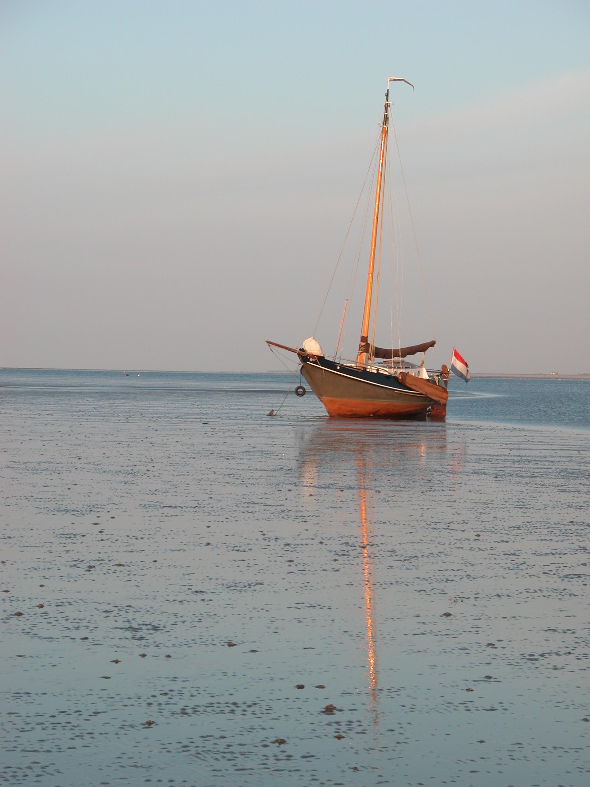 sail boat sailboat small yacht wooden mast sail furled up anchored