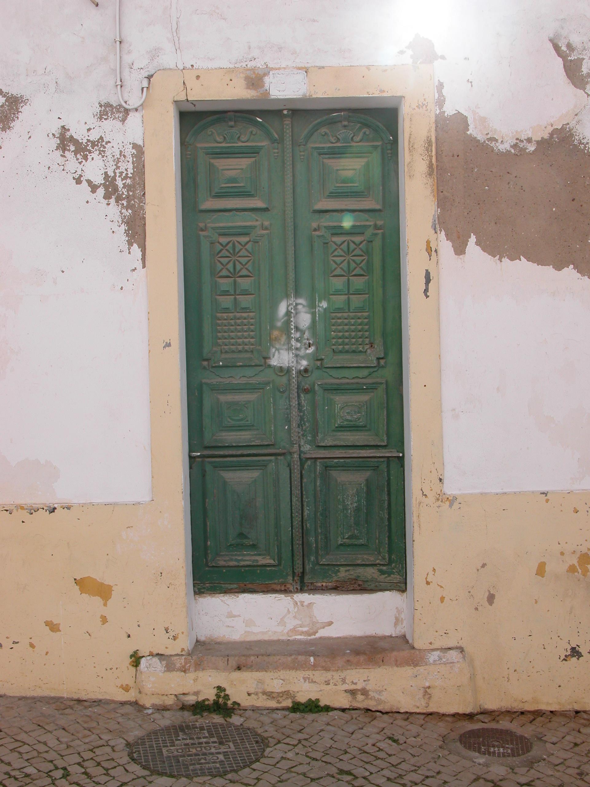 door in old wall plaster