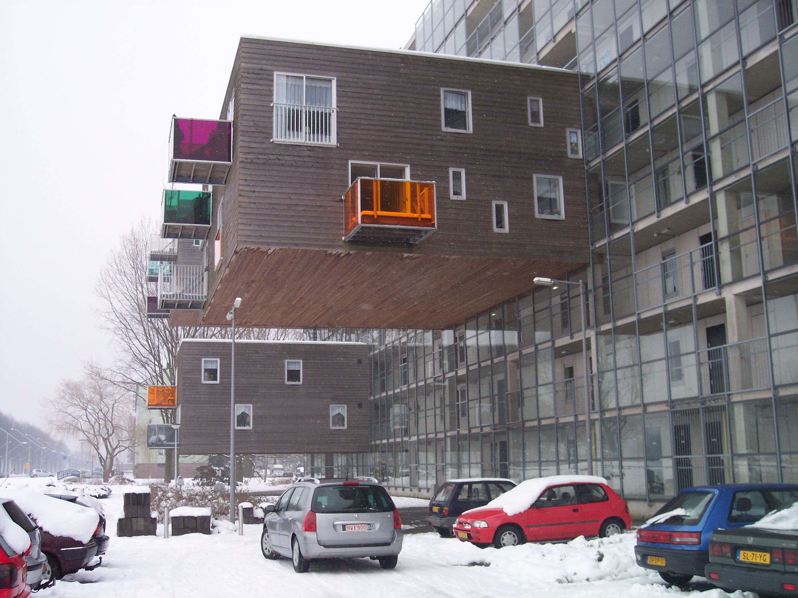 dario houses sticking out modern architecture design above the street snow cold winter