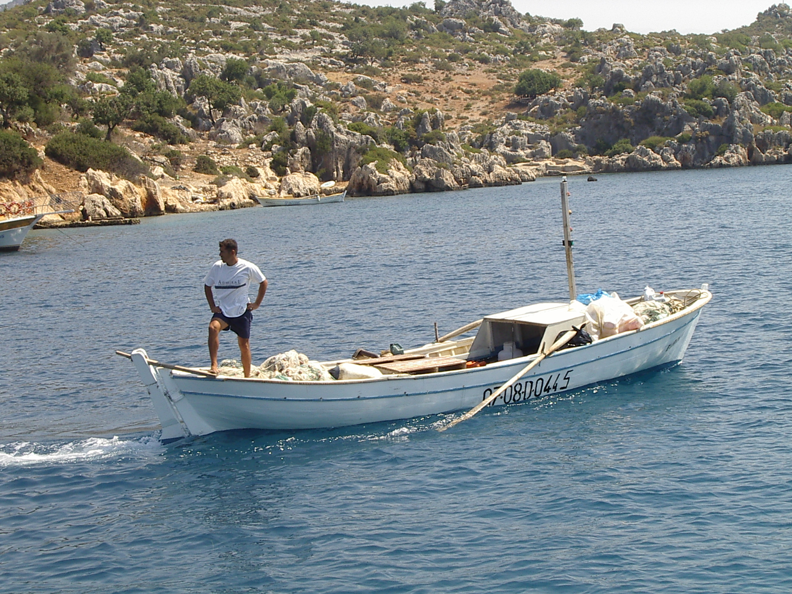 j_d fishers boat fisherman sea shore rock