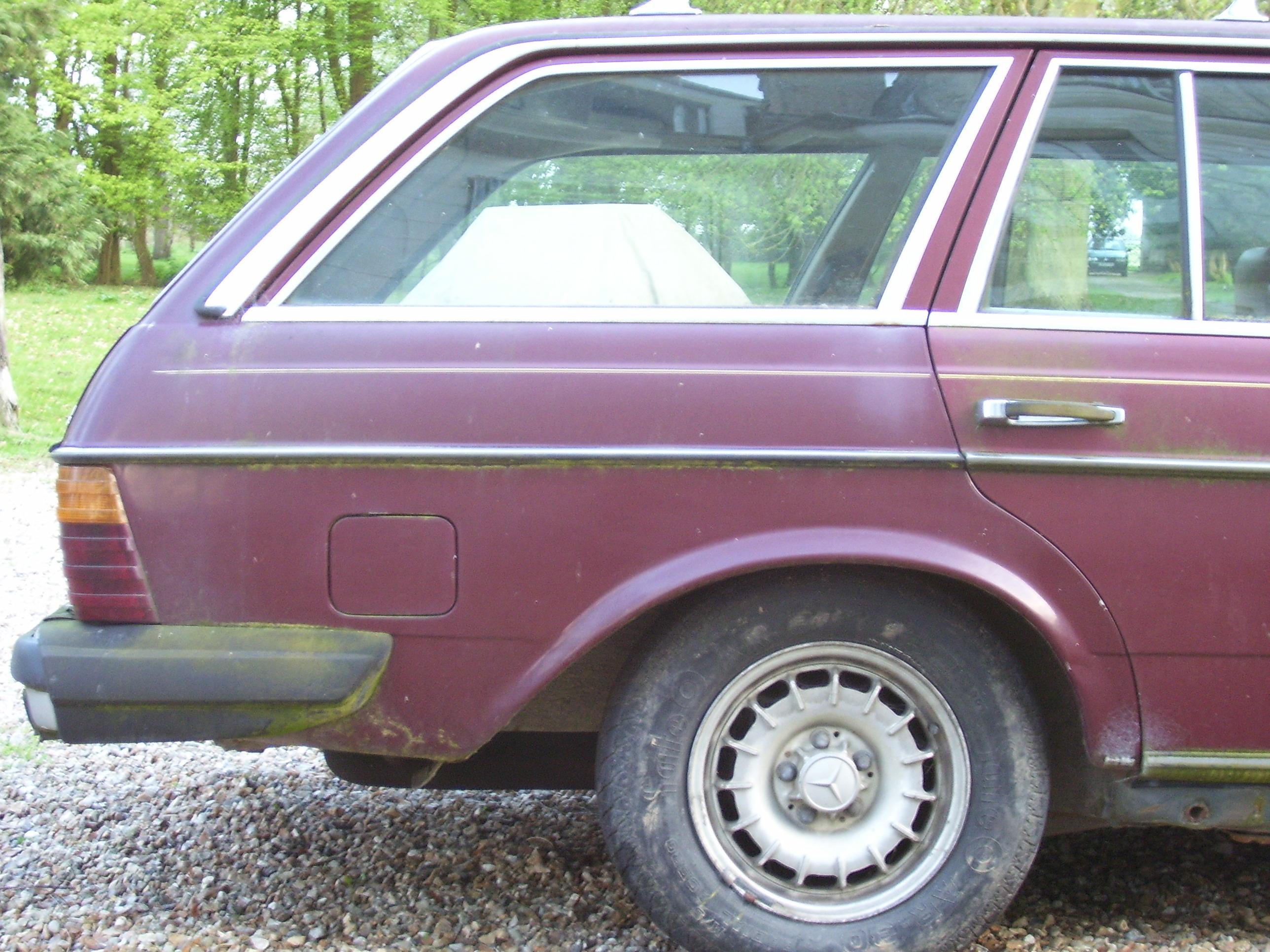 makkes wheel tire car backend boot red volkswagen transportation windows station wagon