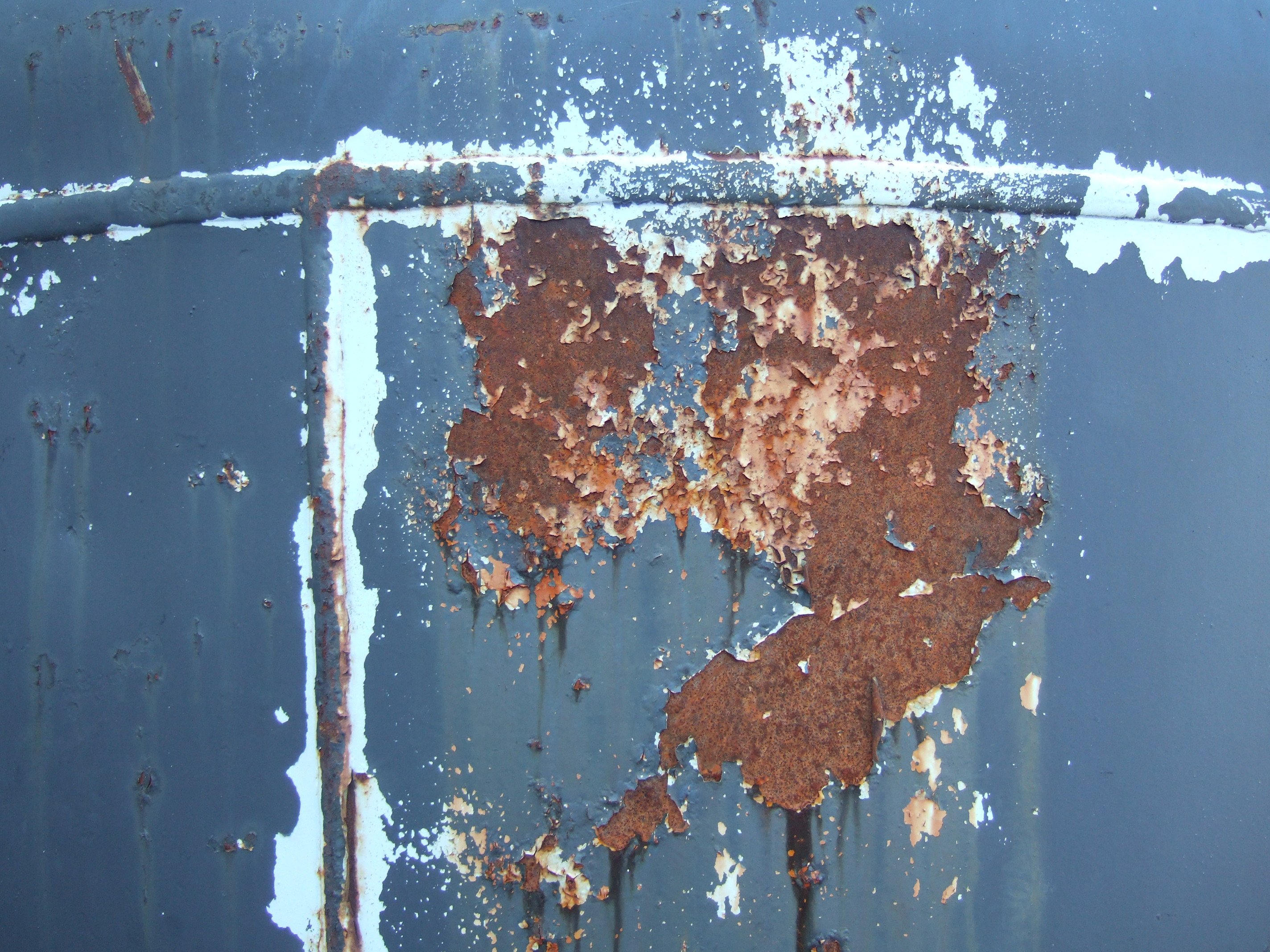 tabus rust blue paint pealed off