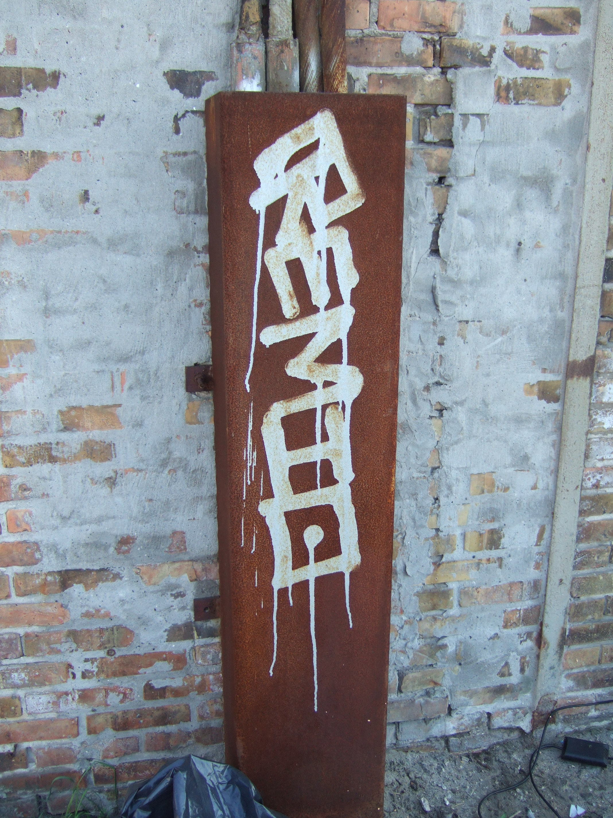 tabus graffiti tag rust metal copper wires electricity