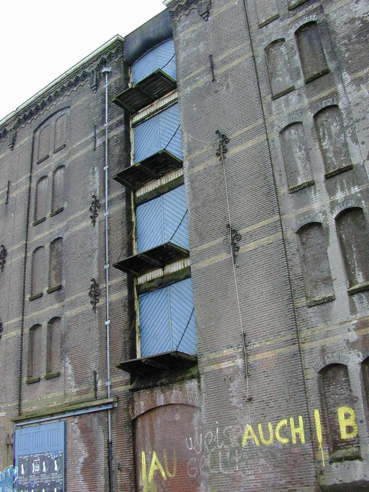 old innercity inner-city building outside front back wall doors loading warehouse