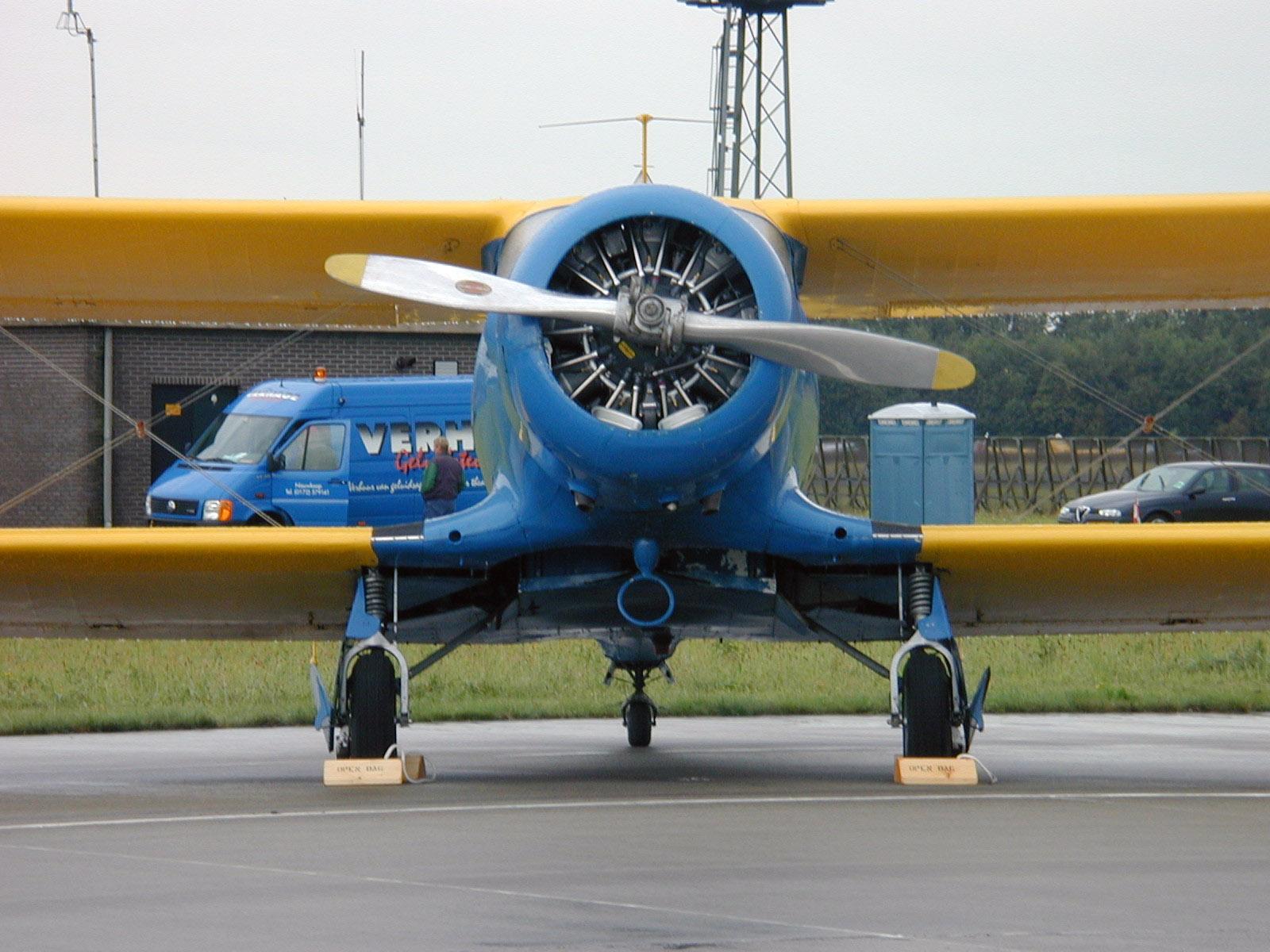 prop propellor twin-decker twin decker yellow blue biplane frontview front engine