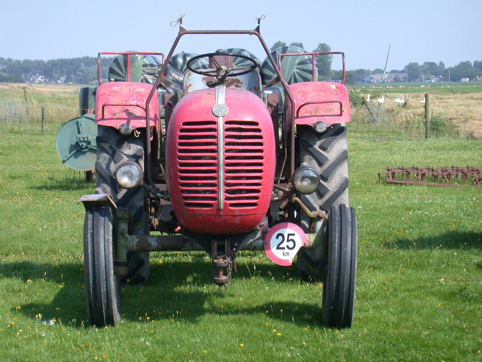 tractor engine red front tires farm equipment 25 km country