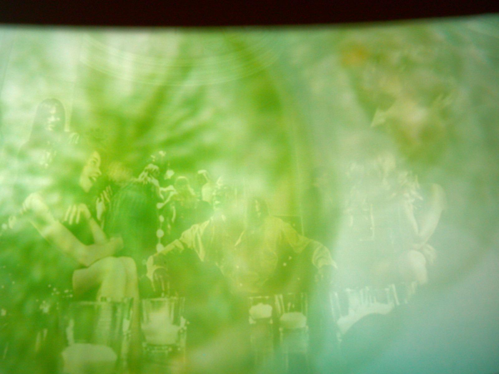 blurs blur club disco bar crowd humanoids humans green haze woman