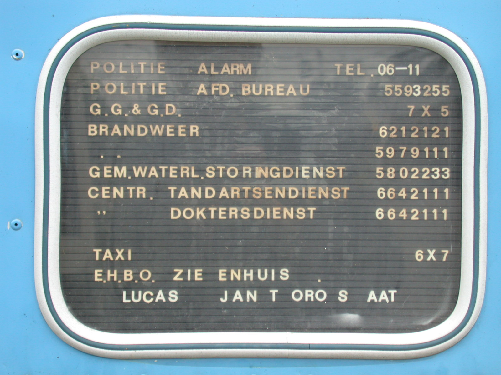 notice board noticeboard letter politie police pinned up plaque placard black and white