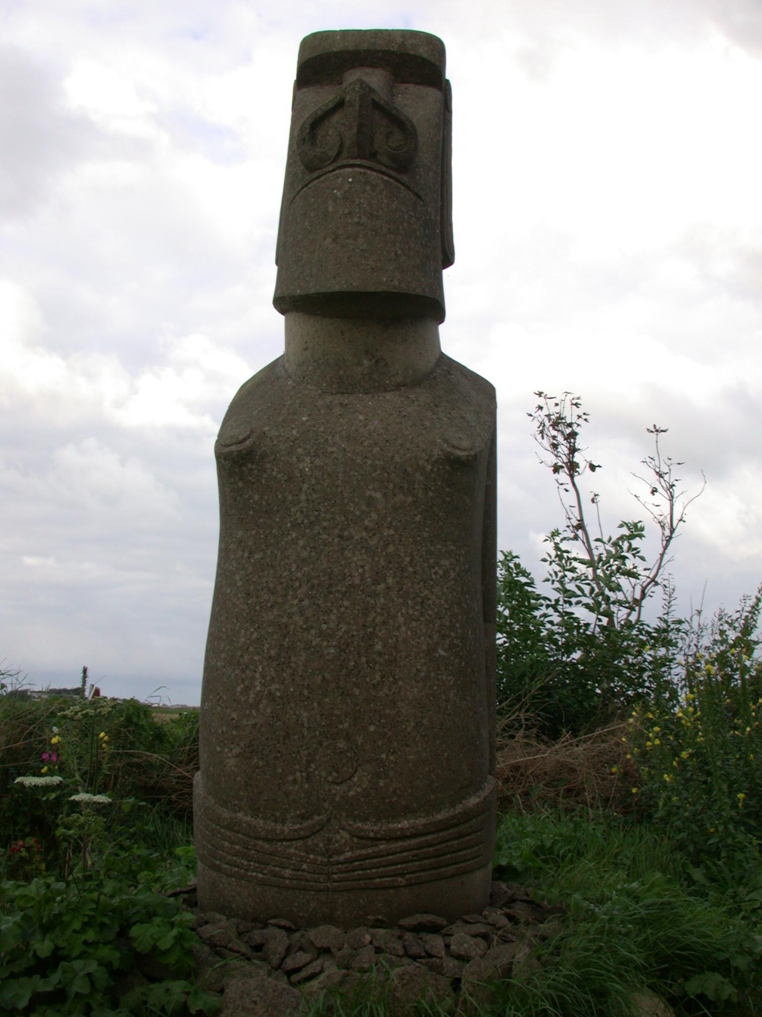 easter island statue green grassstone sculpture