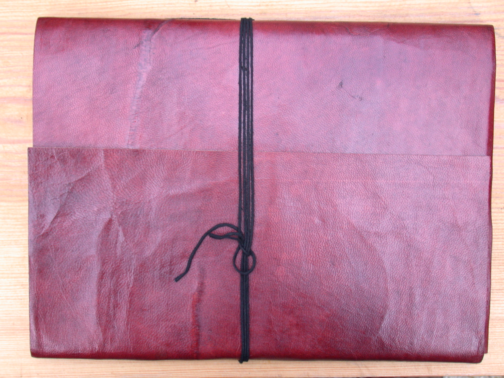 book wrapped wrapping pink purple leather leathery bound with string