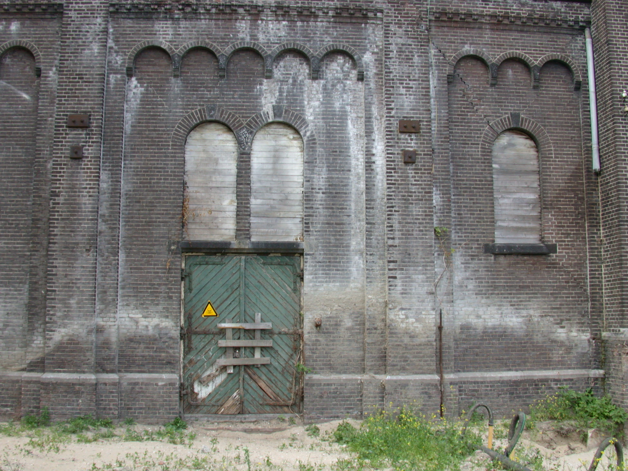 old factory gotham city walls high bricks abandoned closed baorded up windows planks derilict