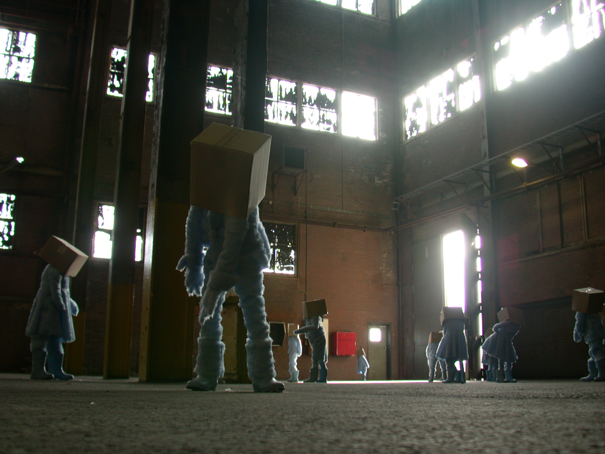 art modern strange figures with boxes on their heads wtf work of artwork old abandoned empty factory