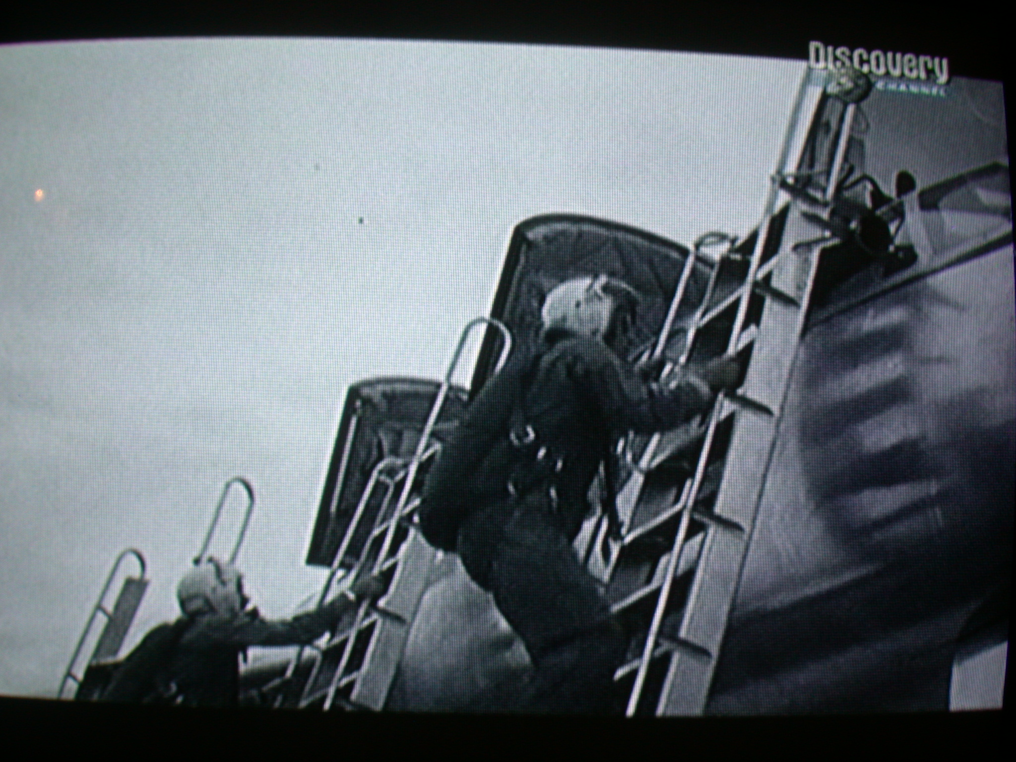 television screen with pilot entering cockpit jet fighter