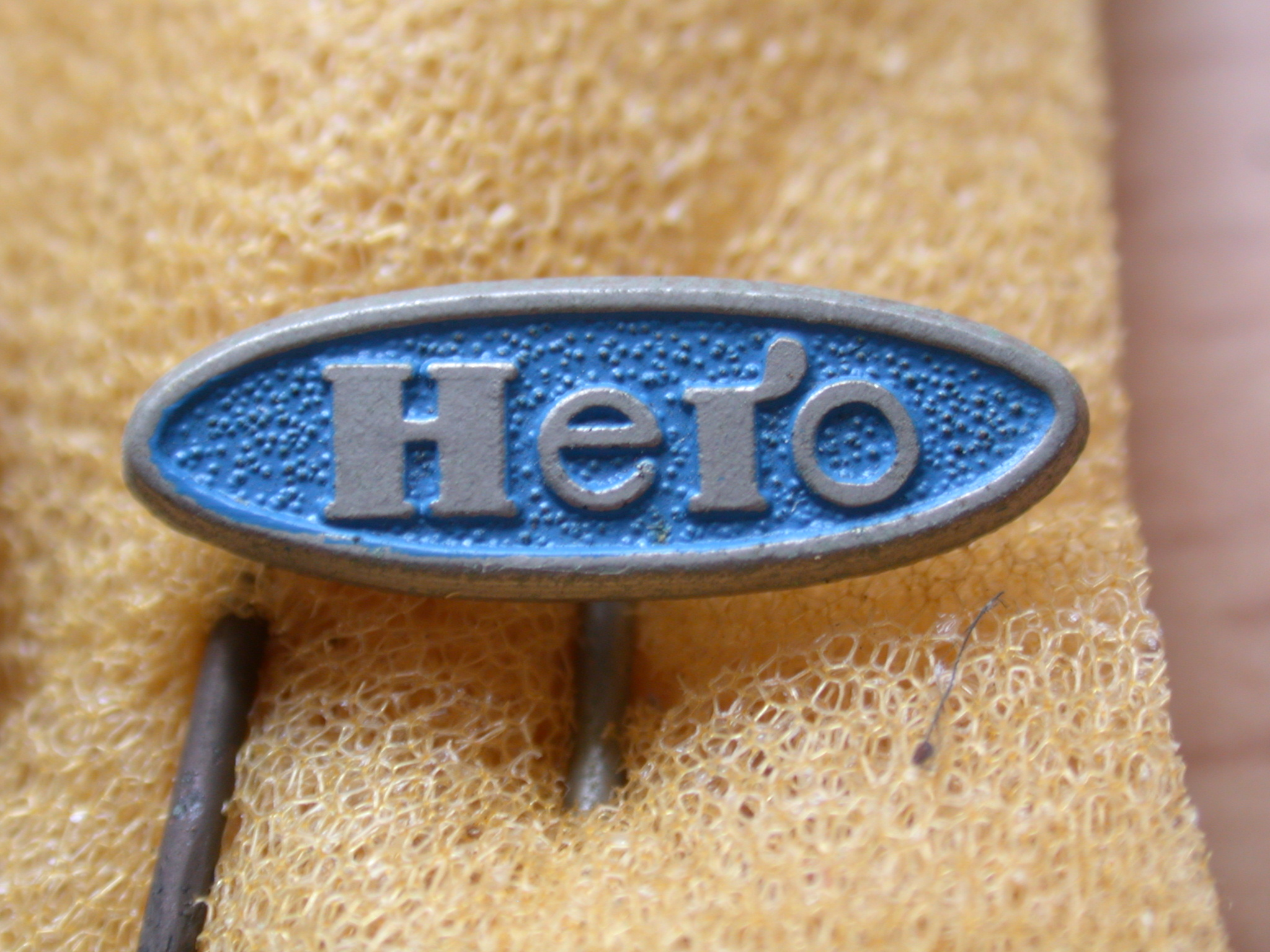 objects signs pin metal logo brand hero typo typography blue oval royalty-free