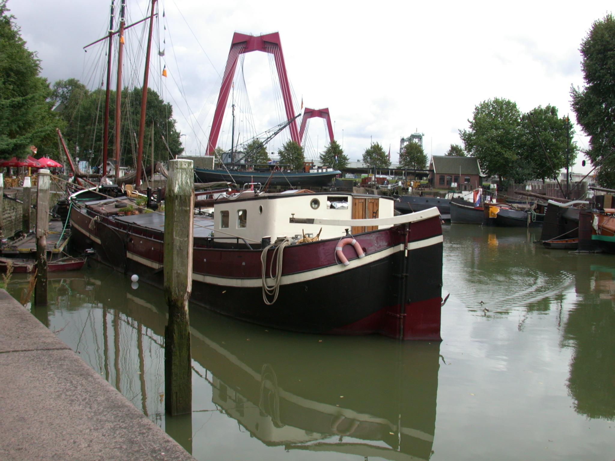 boat ship barge dutch waterway river water bridge black and white