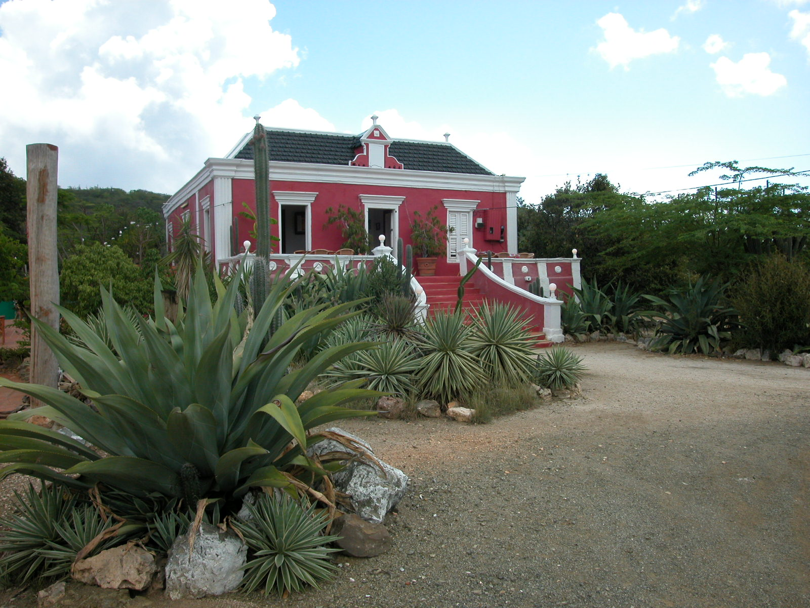 jacco curacao architecture exteriors villa condo stairs staircase entrance house red bushes cactus