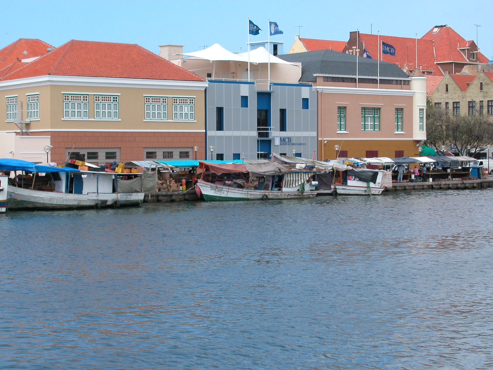 architecture exteriors willemstad curacao jacco water boats quay market river city buildings