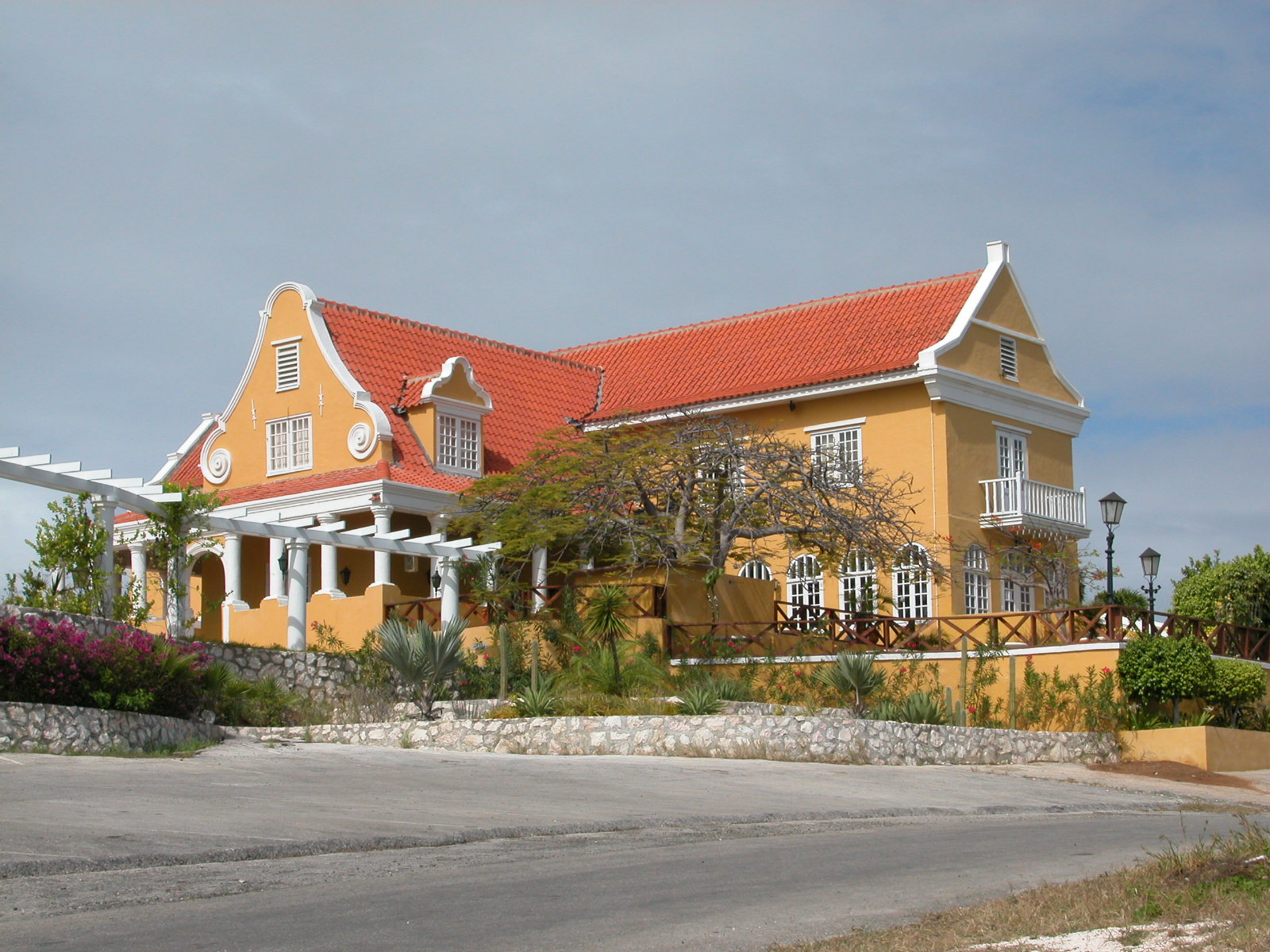 jacco curacao house villa red yellow mansion