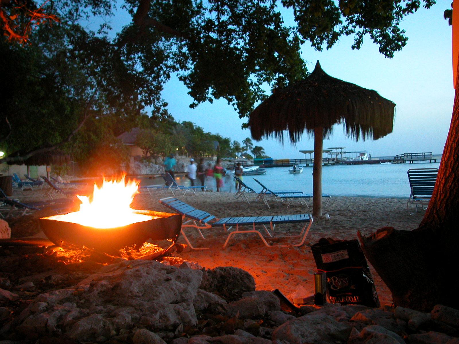 tropical tropic tropics beach party beachparty open fire warm warming flames flame cosy parasol sundown