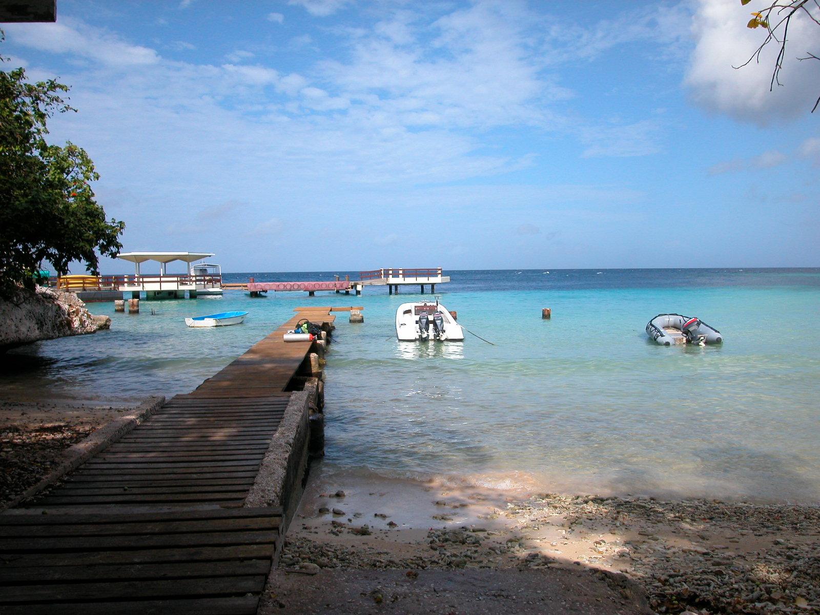 jacco beach pier sea ocean tropical island speed boat speedboat anchored