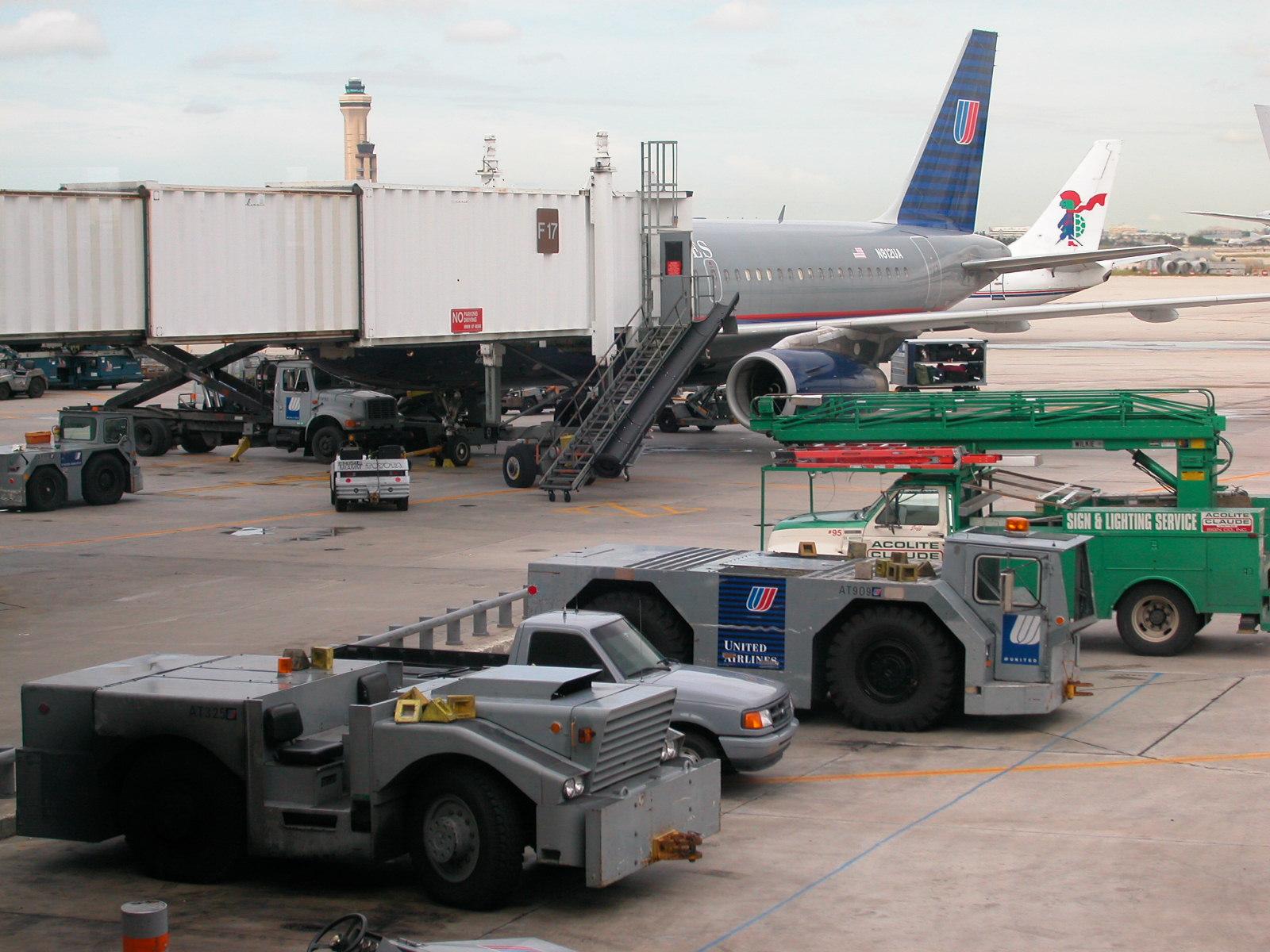 airplane aeroplane vehicles cars loading airport