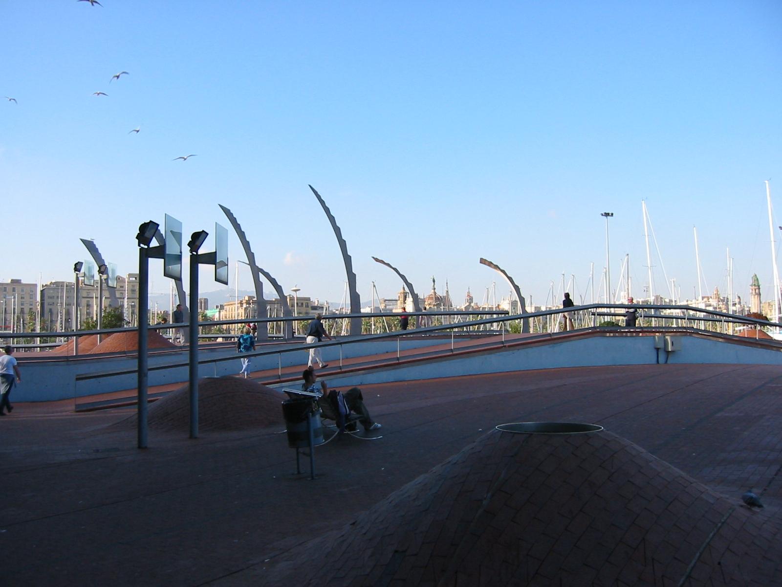 architecture exteriors spain barca barcelona harbour boulevard cityscape bench lamppost art sculptures people