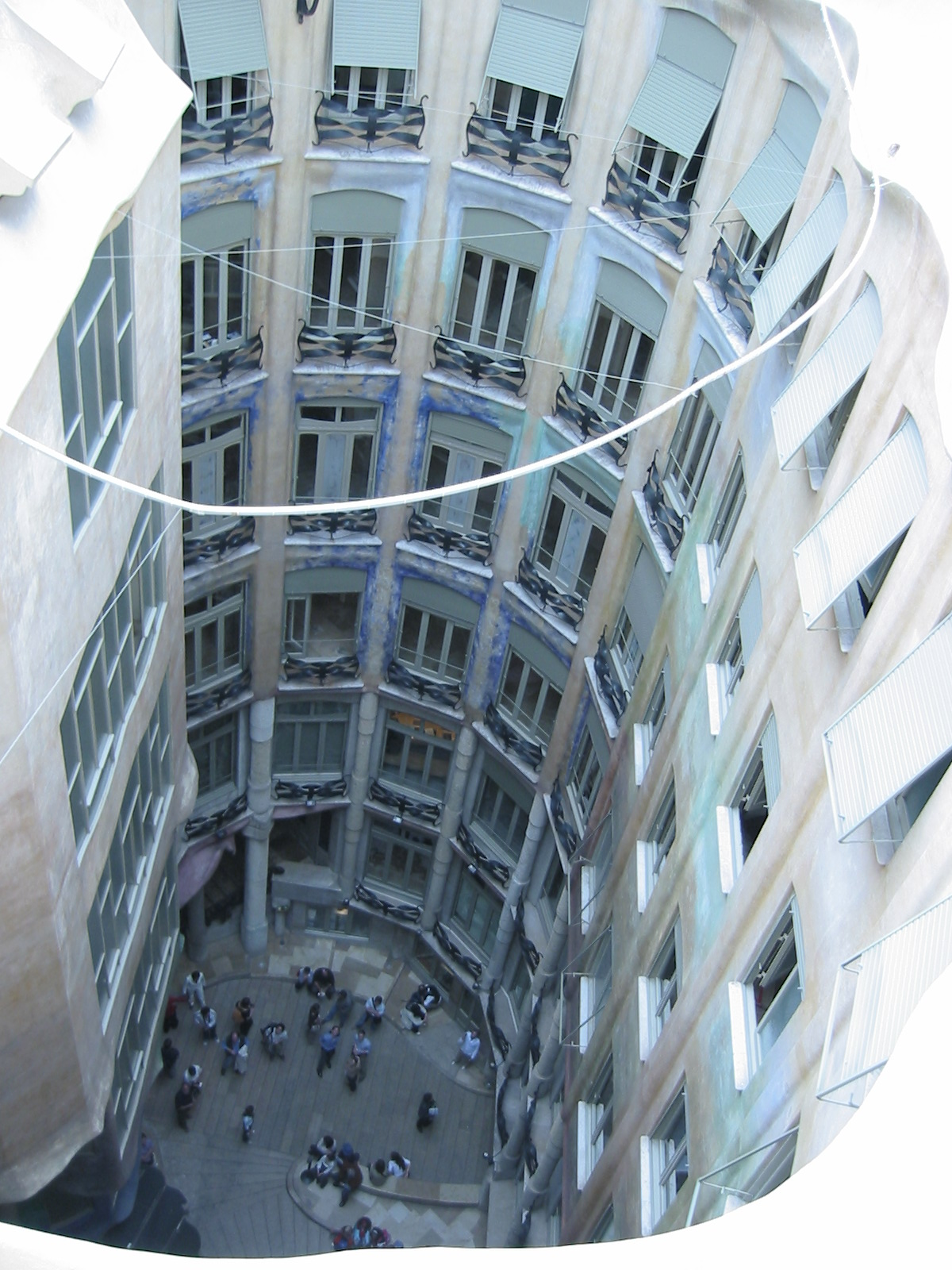 architecture exteriors fascade building barcelona gaudi people crowd square windows