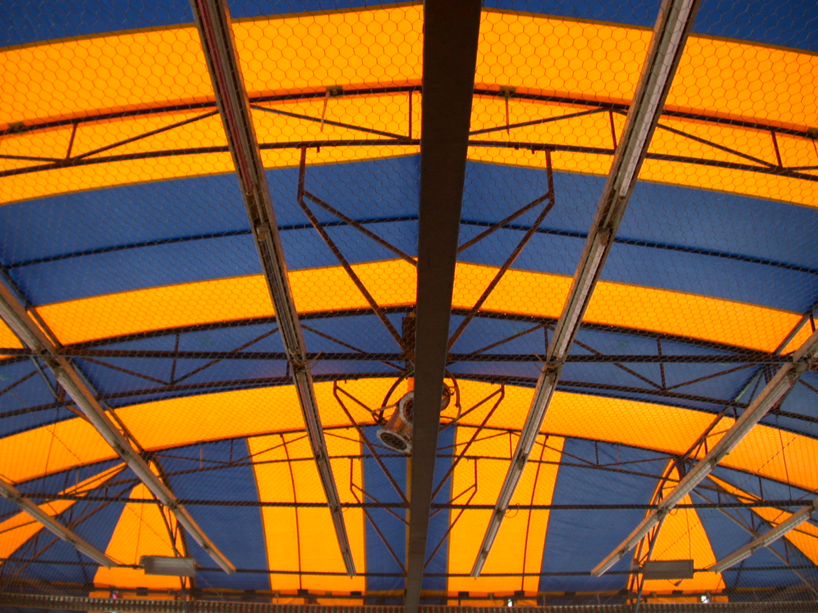 ceiling inside a tent blue yellow disco lights beams